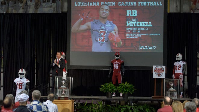 UL coach Mark Hudspeth discusses the signing of Erath's Elijah Mitchell during Wednesday's recruiting bash.