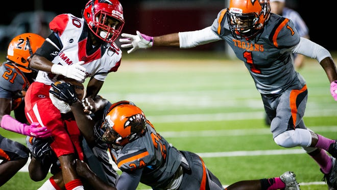 Immokalee High School's Jean Sanon tries to hold on to the ball during a game against Lely High School in Naples, Fla., on Friday, Oct 28, 2016.