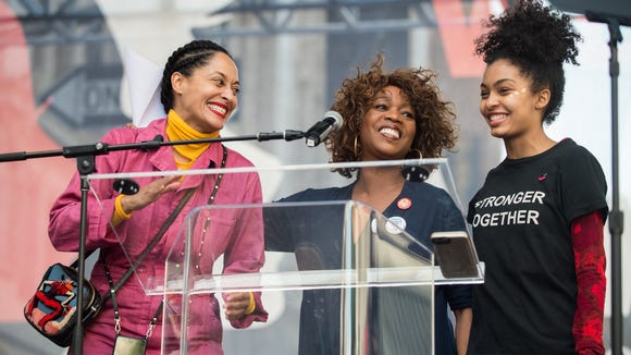 Shahidi with Tracee Ellis Ross, left, and Alfre Woodard, center, speaking onstage at the Women's March in Los Angeles on Jan. 21, 2017.