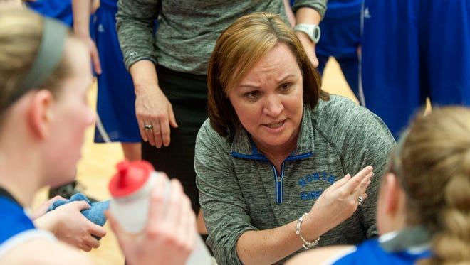 North Harrison head basketball coach Missy Voyles talks to her players during a time-out.18 February 2017
