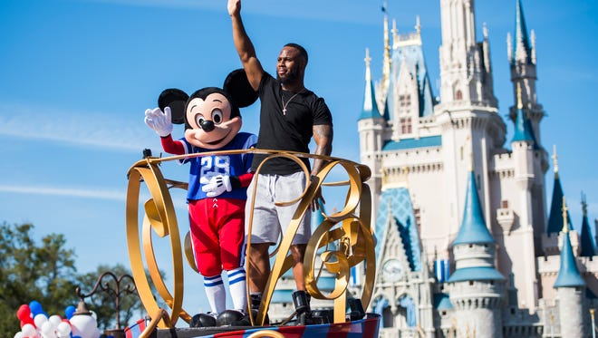 NFL star running back James White joins Mickey Mouse at Disney World in Florida for a celebration after he helped rally the New England Patriots to a 34-28 overtime win over the Atlanta Falcons in Super Bowl LI.