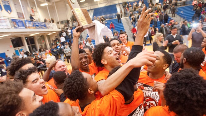 Fern Creek celebrates its trophy in the KHSAA 6th Region Boys Basketball Championship. They beat Doss, 49-4507 March 2017