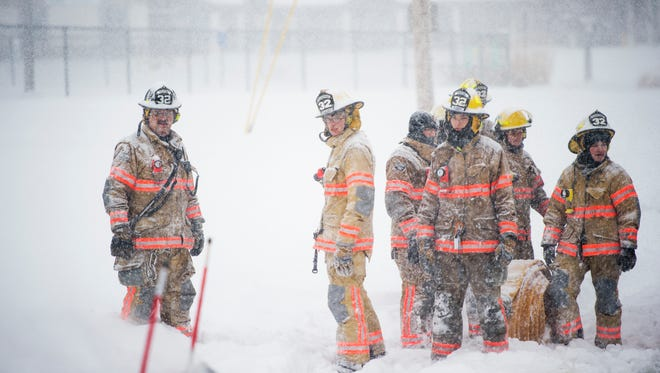 Vestal firefighters near the scene of an overnight blaze March 14, 2017 at the Skylark Motel in Vestal. Emergency response crews battled heavy snowfall.