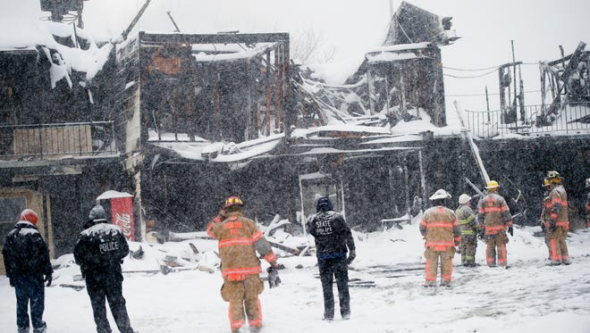 Emergency responders survey the damage after an overnight fire March 14 at Skylark Motel in Vestal. One person was confirmed dead, and another was taken to the hospital with non-life-threatening injuries.