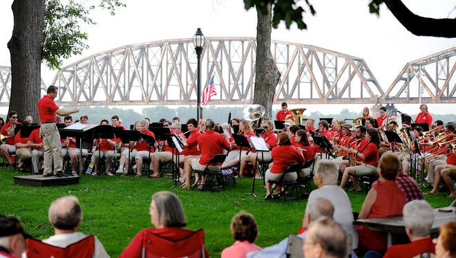 The Community Band performs for a packed Audubon Mill Park on July Fourth 2015.
