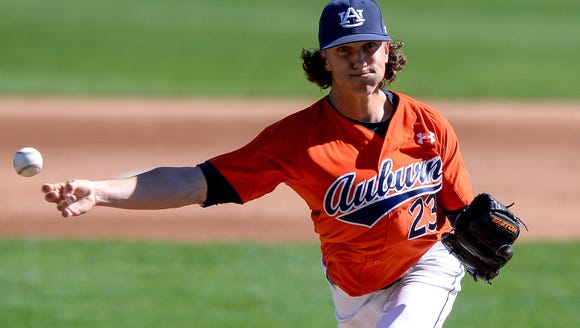 Auburn junior reliever Calvin Coker (23) and his submarine