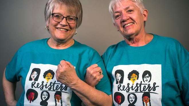 """Judy Seguin,left,  and Sue Dergandz are """"Resisters"""" who are working for progressive change in society by participating in marches and writing politicians to hold them accountable. (Richard Tsong-Taatarii/Minneapolis Star Tribune/TNS)"""