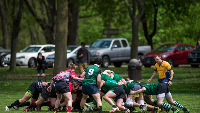 Binghamton Barbarians and Rochester Aardvarks players scrum for the ball during their game at Otsiningo Park in Binghamton on Saturday, May 6, 2016.