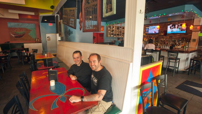 Chef Jonathan Pauly, left, and owner Jared Matthews of Cafe Lou Lou, which soon will be rebranded as Lou Lou Food + Drink. The restaurant is located on Sears Avenue in St. Matthews.