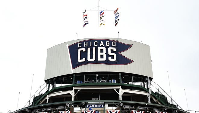A Cubs fan died Wednesday after falling over a Wrigley Field railing on Tuesday night.