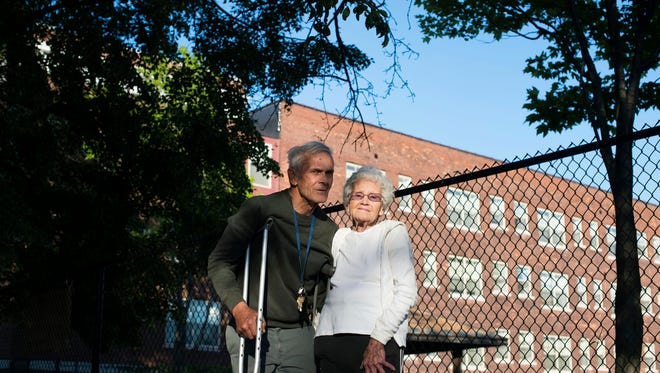 George McMahon and Patsy McMahon pose next to the park they have operated since 1970, that is now sold and locked on Thursday, June 1, 2017 on Brainard Street in Detroit.
