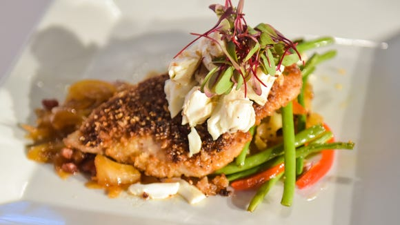 Chef Bonnie Breaux's cracklin-crusted black drum with butter-poachedjumbo lump crabmeat, fennel marmalade and Abita beer-infused Brabant potatoes.