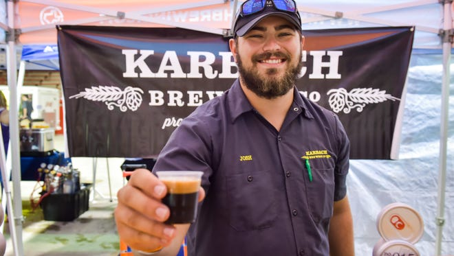"""Josh Lindsay with Karbach Brewing at the 10th annual Gulf Brew event at Blackham Coliseum provides a """"Christmas in July"""" for beer lovers.. Saturday, July 22, 2017."""