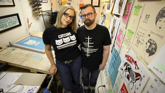 "Brittney ""Cat"" McCormick and husband Justin Kamerer at the small printing space McCormick uses to produce her work.