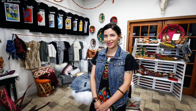 Angelique Sloan, owner of the Shop Mucho online store, sells her wares from a free pop-up shop in a vacant downtown storefront. In August, The Downtown Memphis Commission expanded its Open on Main initiative, a program designed to boost shopping on Main Street.