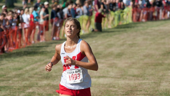 Manual's Alena Sapienza-Wright takes 1st place in the St.X Tiger Run girls varsity 5K race with a time of 18:31.76.26 August 2017