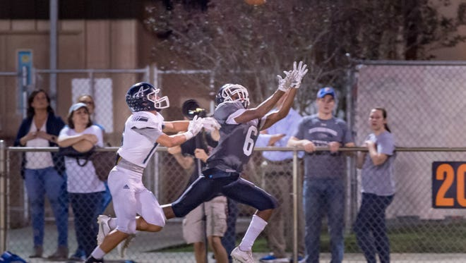 LCA wide receiver Errol Rogers, shown here making an over-the-shoulder catch against Ascension, is off to a great start this season.