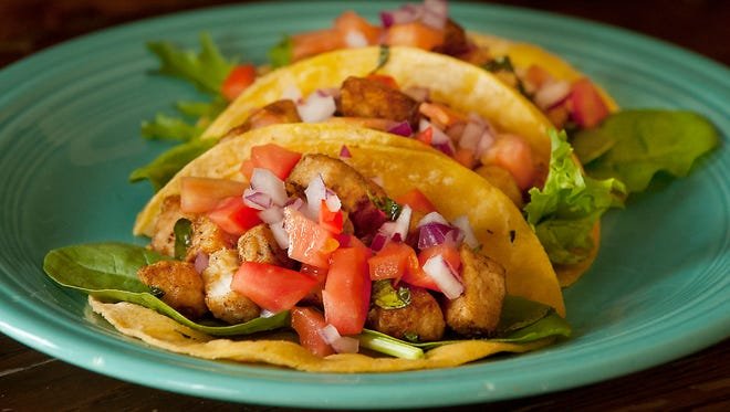 Dragon King's Daughter Restaurant's sautŽed Mahi Mahi taco made with red onions, tomato, spring mix greens, orange zest and basil. 05 September 2017