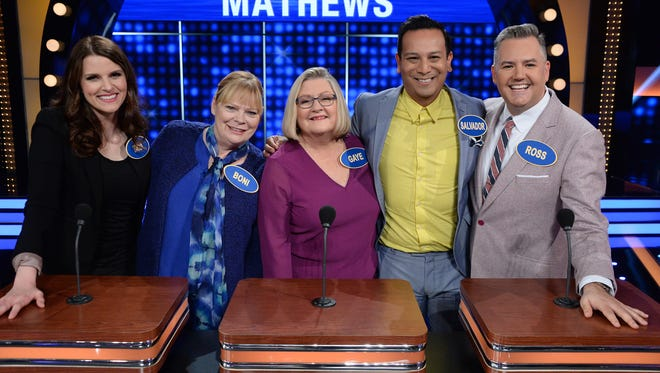 """The families of multiplatinum Grammy Award-winning recording artist Faith Evans and television personality Ross Mathews compete in """"Celebrity Family Feud."""" Mathews on far right is seen with his family including partner Salvador Camarena second from right."""