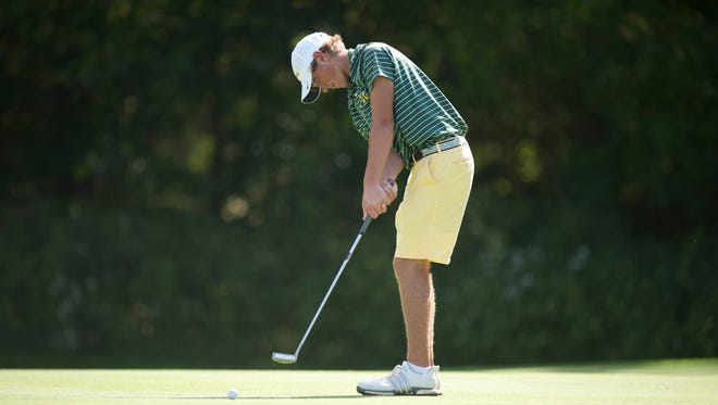 St. Xavier's Drew Doyle putts on the 15th.