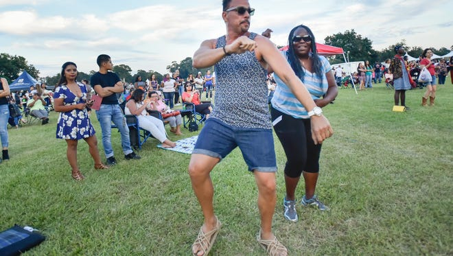 Daniel Gonzalez and Ann Gaines enjoy the 2016 Latin Music Festival at the Horse Farm- Moncus Park. The 2017 festival is Oct. 21 and free.