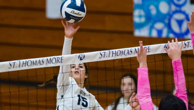 Lizzy Low hitting as STM volleyball takes on Pope in tournament at St Thomas More. Saturday, Oct. 21, 2017.
