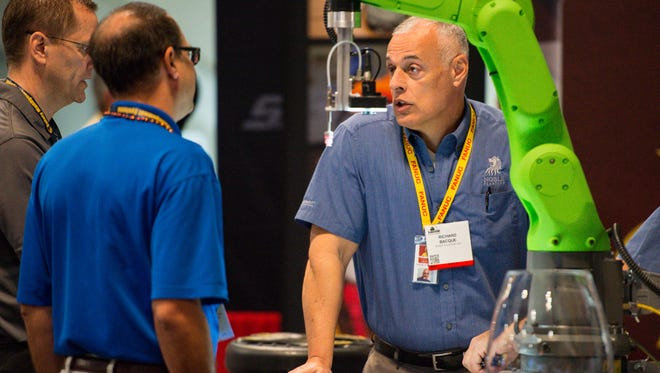 Richard Bacque with Noble Plastics talking with customers at The Louisiana Gulf Coast Oil Exposition - LAGCOE at the Cajundome. Tuesday, Oct. 24, 2017.