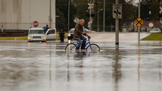 Heavy rains cause street flooding in Lafayette.  Wednesday, Nov. 1, 2017.