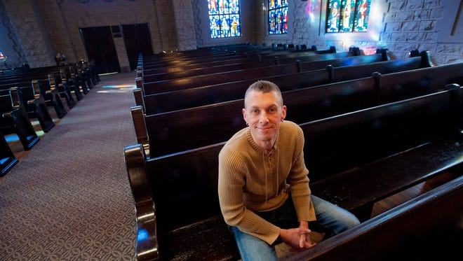 """Maurice """"Bojangles"""" Blanchard, a volunteer at Highland Baptist Church (where he leads an LGBT ministry), sits in the pews inside the church's sanctuary. Blanchard is a gay man who has been part of a movement in a faction of the Cooperative Baptist Fellowship churches urging church leaders to drop a ban on hiring people who are LGBT."""