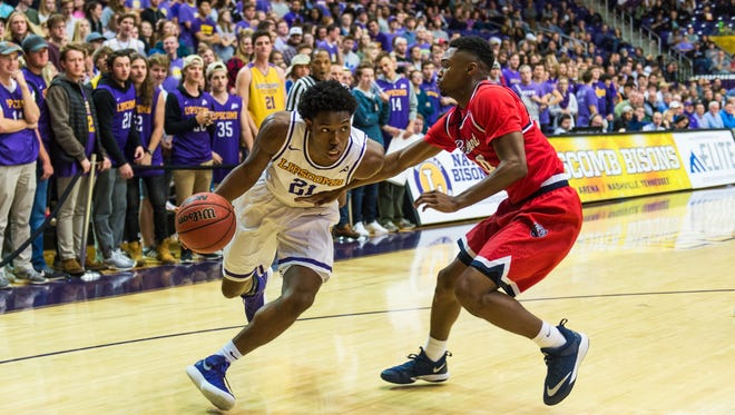Lipscomb's Kenny Cooper drives toward the basket against Belmont's Kevin McClain in Monday night's game at Allen Arena.
