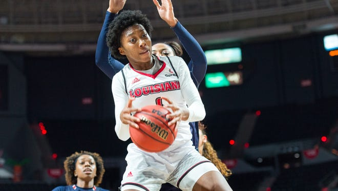 UL's Kim Burton pulls down one of her five rebounds during the Cajuns' 70-60 loss to Auburn on Friday in the Cajundome.