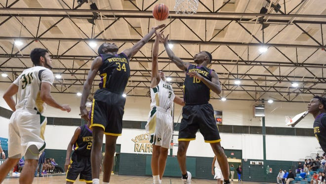 Westgate's Keith Lopez (34) continued his dominance in the paint during the Tigers' 50-44 road win over Acadiana on Monday.