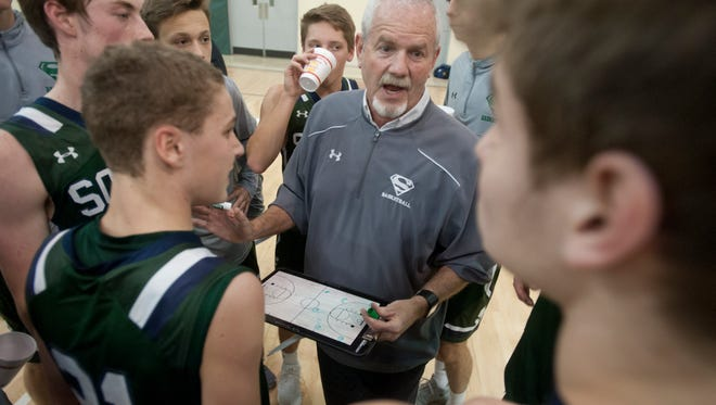 South Oldham head basketball coach Steven Simpson talks to his players during a time-out in the Jeff and Julie Beyke Boys Basketball Classic at S. Oldham.