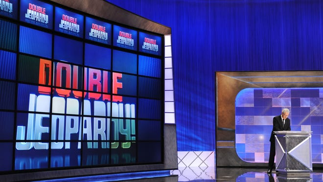 """Game show host Alex Trebek rehearses his lines on the set of the """"Jeopardy!"""""""