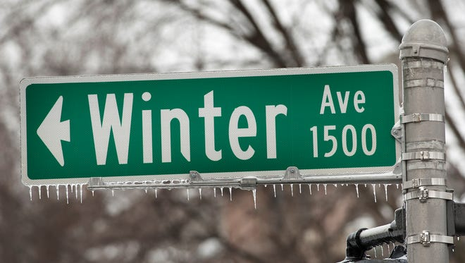 Icicles hang from a sign where Grinstead Ave. becomes Winter Ave. Jan. 13, 2018