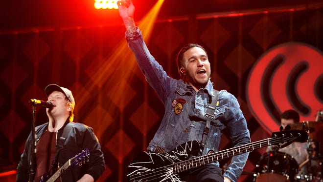 Patrick Stump and Pete Wentz of Fall Out Boy perform onstage during KISS 108's Jingle Ball 2017 presented by Capital One at TD Garden on December 10, 2017 in Boston.