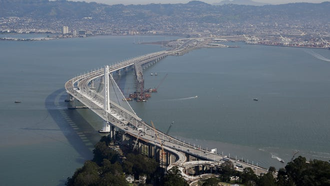The San Francisco-Oakland Bay Bridge is seen in San Francisco. It could cost $9 to cross the Oakland-San Francisco Bay Bridge if the region's voters approve toll increases to pay for transportation improvements in the notoriously gridlocked region.