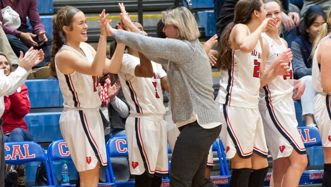 Sacred Heart head basketball coach Donna Moir slaps the hands of Sacred Heart forward Amy Barry after their team captured the 46th annual Girls Louisville Invitational Tournament championship defeating Mercer County 83-49.