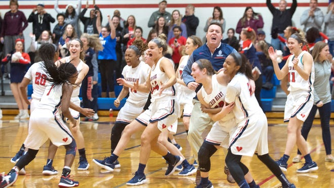 Sacred Heart celebrates its come-from-behind last seconds victory over Campbell County.