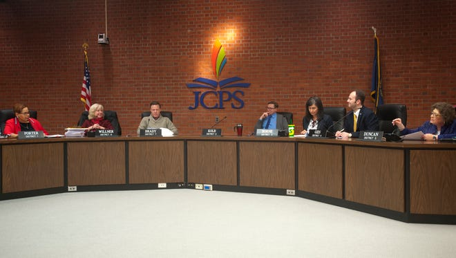 L-R: Jefferson County Board of Education President Diane Porter, Lisa Willner, Chris Brady, Chris Kolb, Stephanie Horne, Benjamin Gies and Linda Duncan review questions to be given to the two finalists for the position of Jefferson County Public Schools Superintendent. The board then went into executive session to interview the candidates. Marty Pollio, the acting superintendent, and Mike Raisor, chief operations officer for JCPS.   Feb. 11, 2018