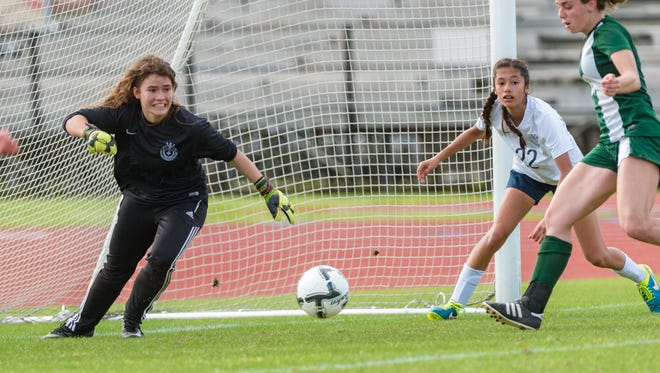 ESA keeper Ella Frantzen sees the ball live in the box during the Lady Falcons' 2-0 loss to Newman on Friday.