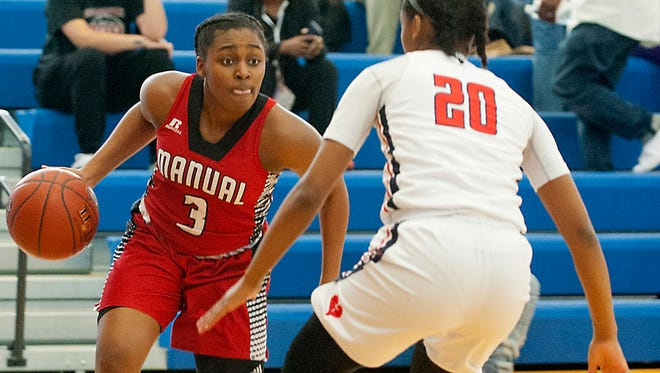 Manual guard Jaela Johnson looks to drive around Sacred Heart guard Kia Sivils in the Region 7 girls basketball championship.Mar. 03, 2018