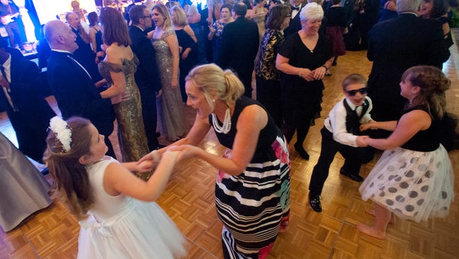 Betsy Cowan dances with her mother, Catey, at the 60th annual Derby Fillies Ball at Galt House East. April 14, 2018