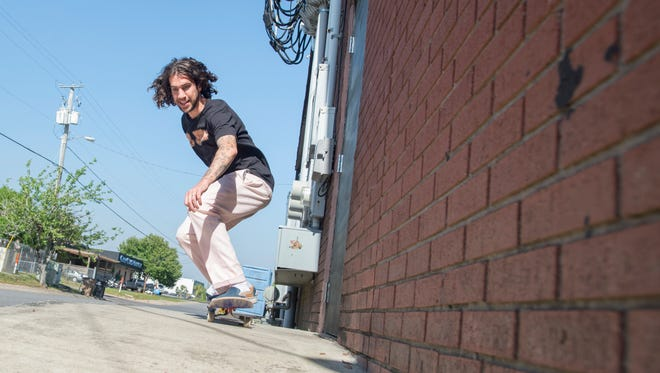 Chase Marcanio skateboards along East Heinberg Street in Pensacola on Thursday, April 19, 2018.  Marcanio is happy to hear that Pensacola will not be imposing a citywide ban.