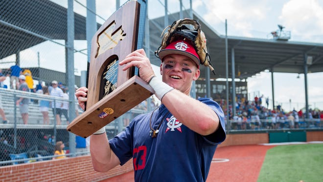 Teurlings Catholic's Peyton LeJeune, shown here holding the 4A state title trophy as the MVP, signed with the UL Ragin' Cajuns on Wednesday.