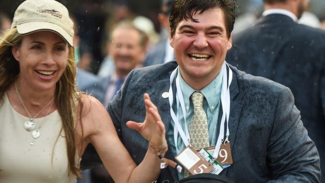 Sean Tugel, right, a native of Avon, Livingston County, heads to the winner's circle at the Kentucky Derby with Tanya Gunther, breeder of Justify. Tugel is assistant racing manager/director of bloodstock services for famed WinStar farm in Kentucky, which is part of Justify ownership group.