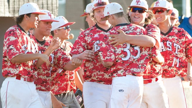 Bullitt East starting pitcher Garrett Simpson is hugged by his teammates after the team's victory over Fern Creek in the 24th District baseball championship final game.