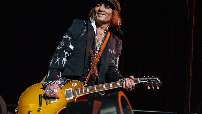 Johnny Depp, seen here playing at London's Wembley Arena with his band the Hollywood Vampires, said his accountants' lawsuit actually lowballed what he spent on wine and shooting Hunter S. Thompson's ashes into the sky.