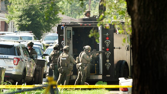 Louisville Metro Police, SWAT and bomb squad members work a barricade situation on June 27, 2018.