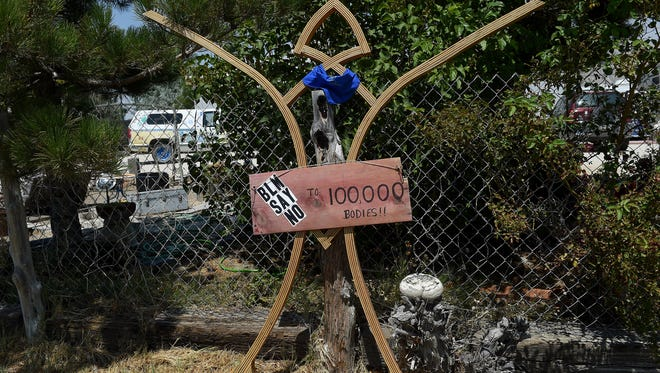 A Burning Man sculpture with a message is seen in front of Gerlach resident Laura Blaylock's home on July 24, 2018.